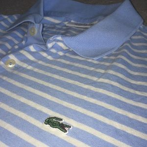 Light blue and white Lacoste polo. Good condition.